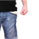 man in jeans torso showing his empty pockets