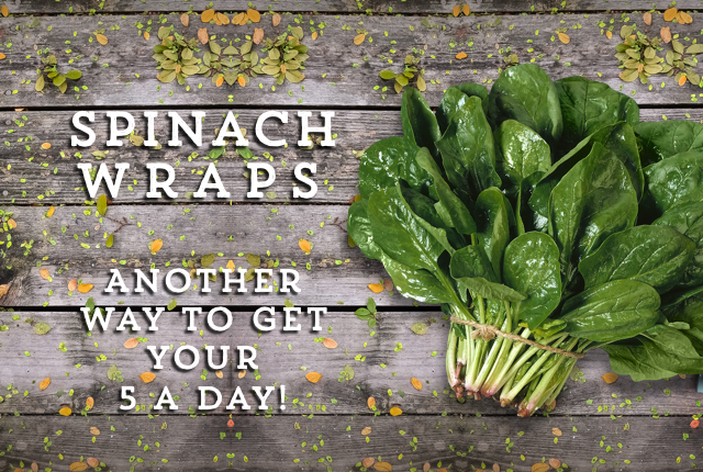 Bundle of Spinach next to some writing
